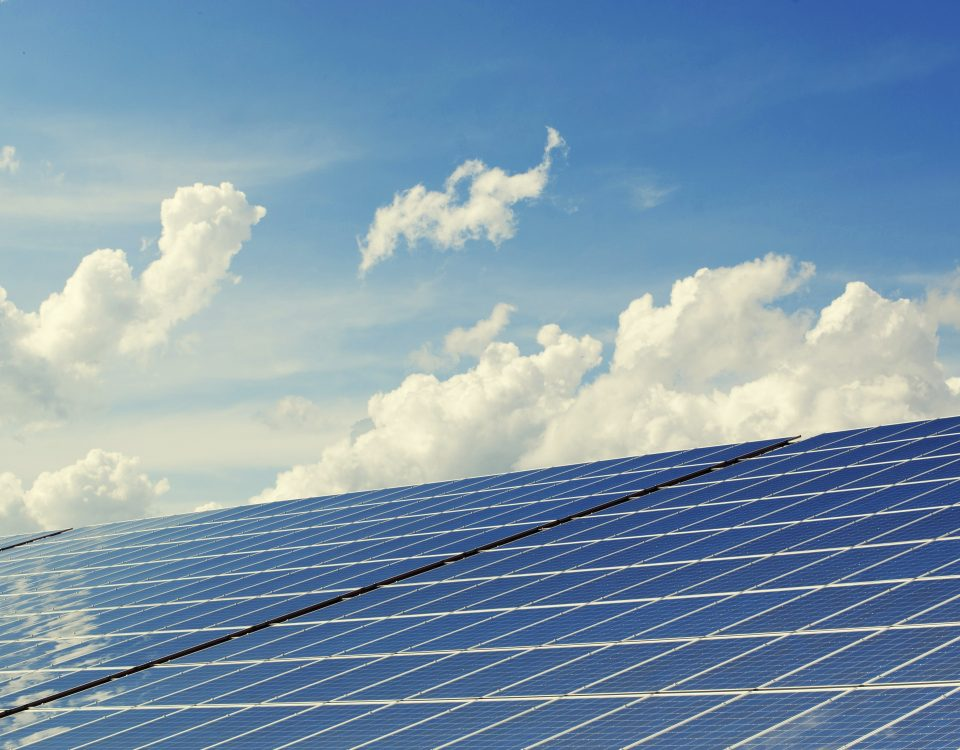 solar panels and blue sky with clouds