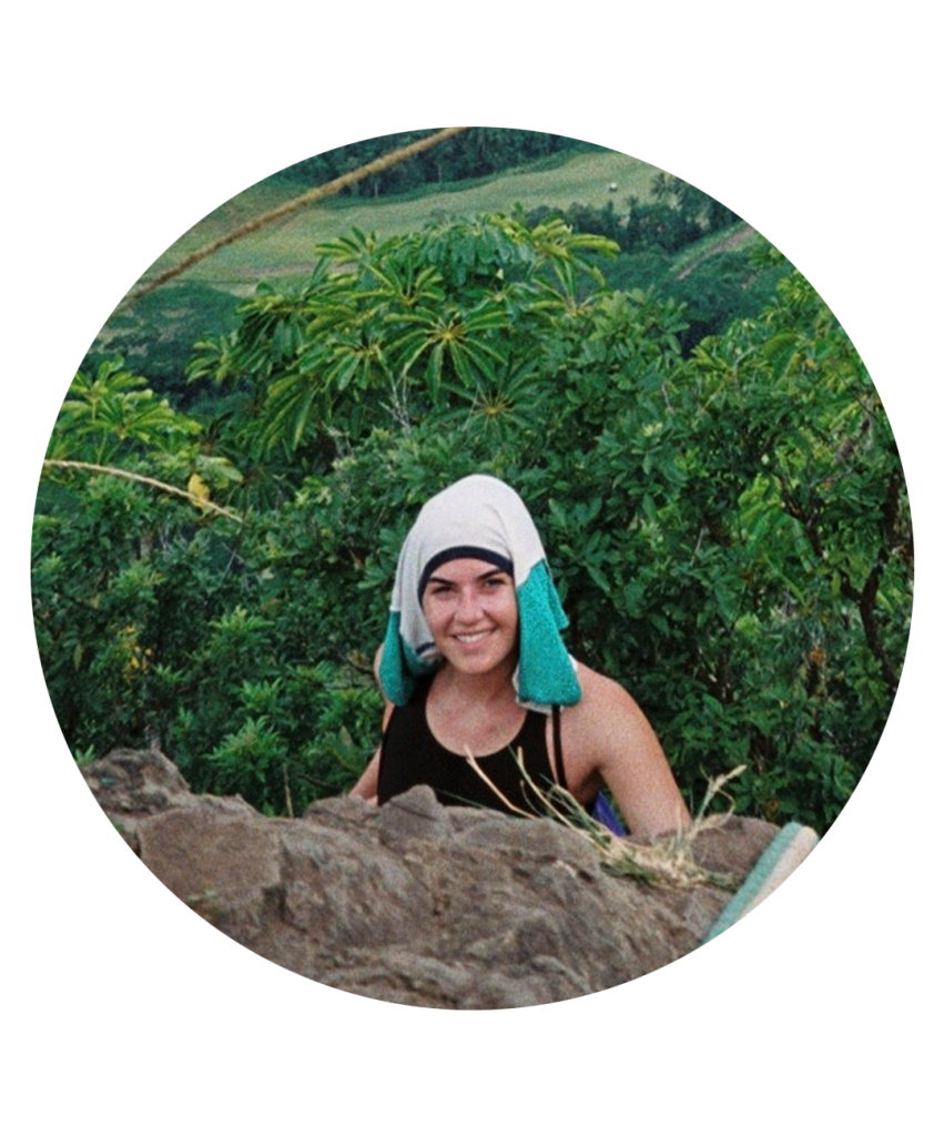 Woman rock climbing in jungle